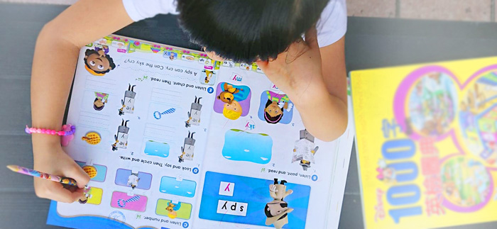 Workbook time in the 50/50 Oral and Phonics class